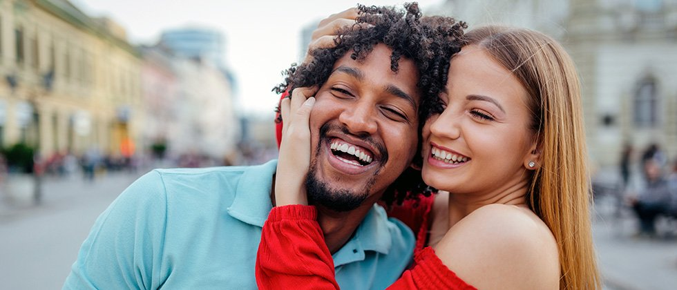 A couple embrace on a city street