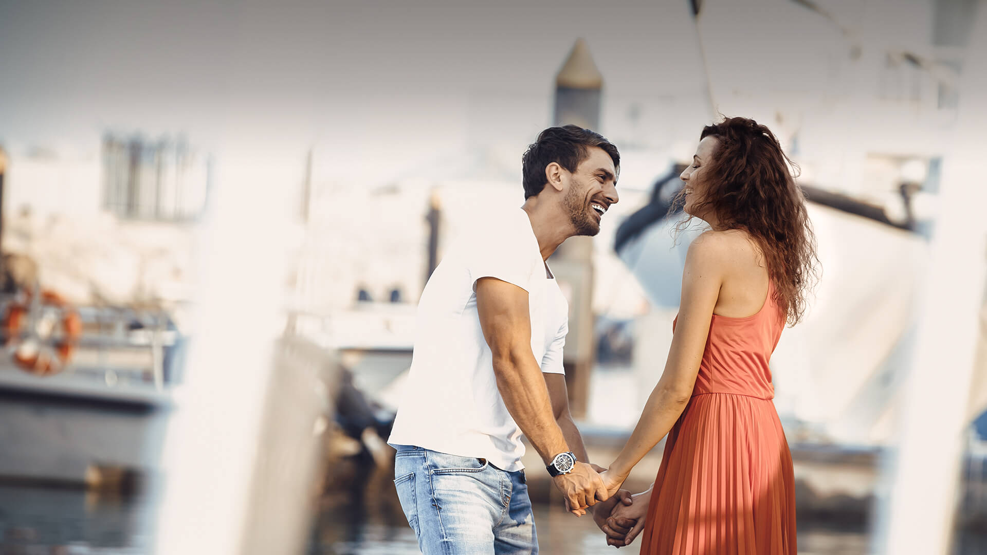 Arab dating symbolized by a man and woman holding hands and standing happily at the port in UK