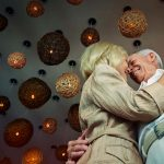 Senior dating symbolized by a couple that is dancing happily in love in a romantic atmopshere in UK