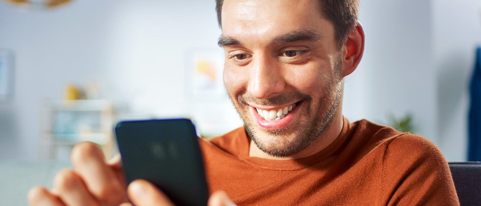 A man checks out dating profiles on his phone
