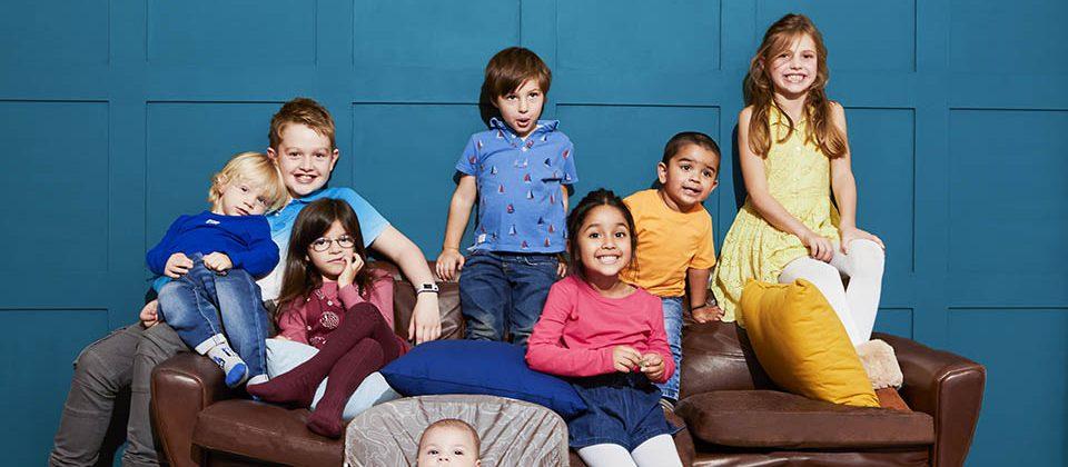 many kids on a sofa