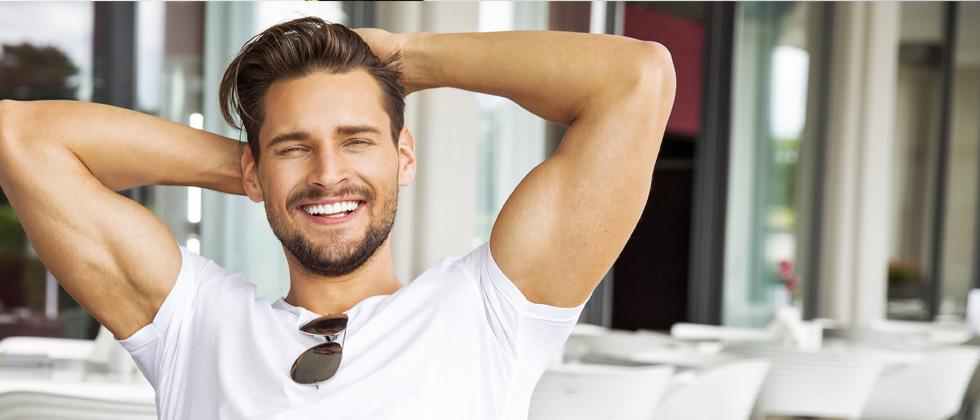 Short guy smiles at the camera