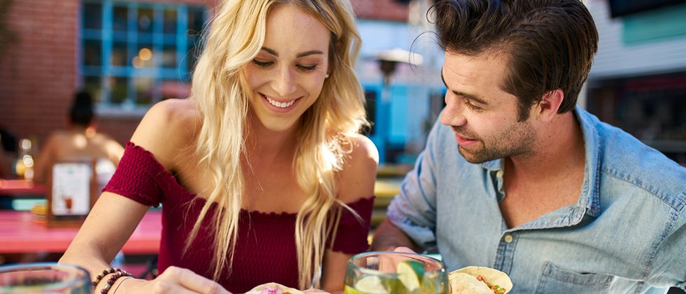 Young couple in a restaurant as a first date idea
