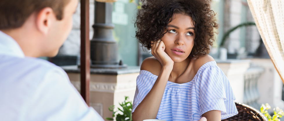 Woman looks thoughtful because he loses interest