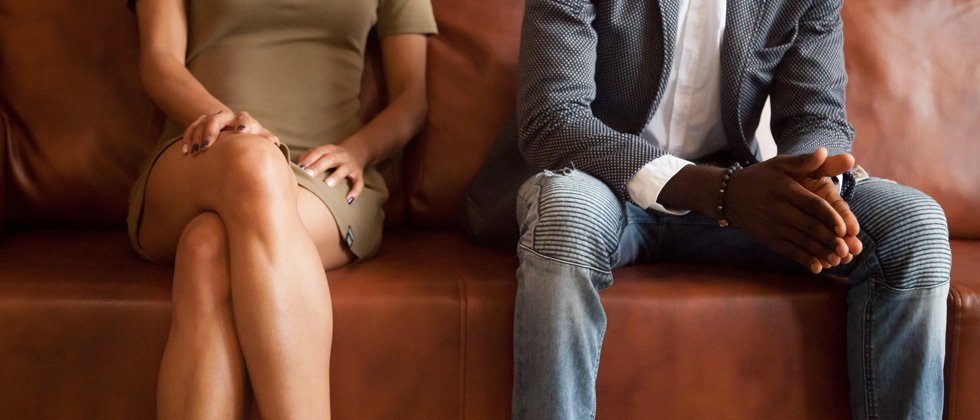 Man and woman sitting with distance as symbol for space in relationship