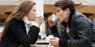 Woman and man on their third date drinking coffee