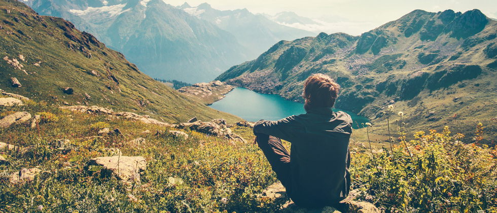man sits alone on mountain as symbol of what to do when he pulls away