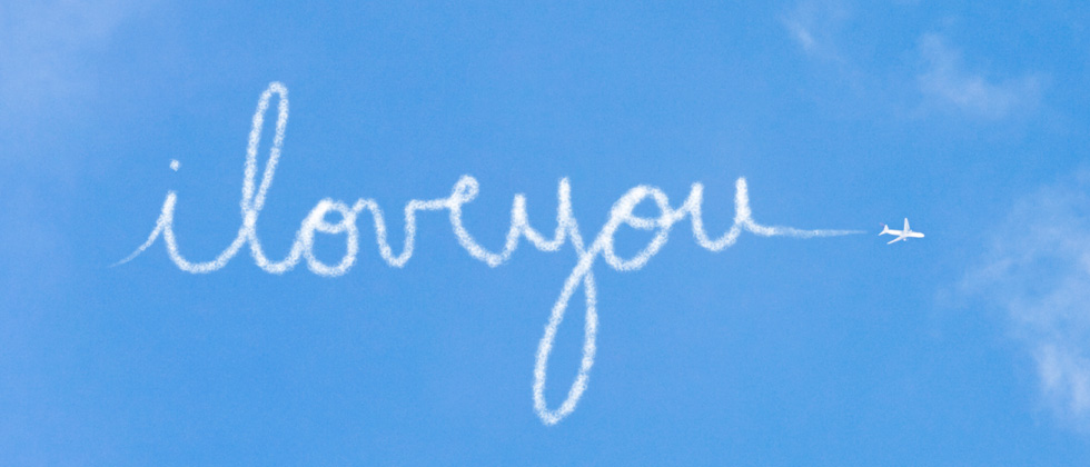 """Text """"I love you"""" on blue blackground"""