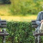 Man and woman sitting on the bench - she thinks about how to ask a guy out