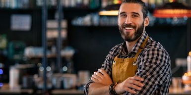 Man standing and smiling to the camera as symbol for what to look for in a guy